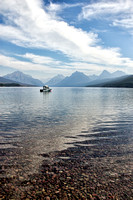 Small boat plying the waters of Lake McDonald; photograph by Crystal Nederman.