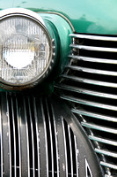 Color photograph of a Cadillac grill and headlight by Crystal Nederman