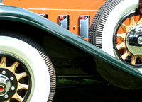 Color photograph of the wooden wheels and running board of a 1930 Packard by Crystal Nederman