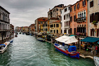 Photograph of the canals of Venice, Italy lined with boats by Crystal Nederman
