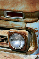Color photograph of a rusted Chevy truck headlight by Crystal Nederman