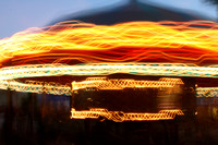 Time lapse photograph of a carousel at the carnival by Crystal Nederman