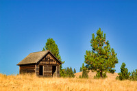 This is a photograph of an abandoned cabin in Montana by Crystal Nederman.