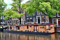 Houseboat on the canals in Amsterdam, Netherlands by Crystal Nederman