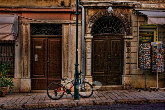 Bicycle and souvenir shop on the cobblestone streets of Rovinj, Croatia by Crystal Nederman